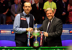 Mark Williams with the trophy after winning the 2018 Betfred World Championship at The Crucible, Sheffield.