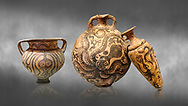 Minoan pottery with stylised octopus decorations, 1500-1400 BC, Heraklion Archaeological Museum, grey background.<br />   <br /> From Left to right<br /> 1- Krater Episkopi Lerapetra 1370-1250 BC, <br /> 2- flask with Marine style stylised octopus design,   Palaikastro,  1500-1450 BC; <br /> 3- far right  conical rhython with Marine style stylised octopus design,   Palaikastro 1500-1450 BC; .<br /> <br /> If you prefer to buy from our ALAMY PHOTO LIBRARY  Collection visit : https://www.alamy.com/portfolio/paul-williams-funkystock/minoan-art-artefacts.html . Type -   Heraklion   - into the LOWER SEARCH WITHIN GALLERY box. Refine search by adding background colour, place, museum etc<br /> <br /> Visit our MINOAN ART PHOTO COLLECTIONS for more photos to download  as wall art prints https://funkystock.photoshelter.com/gallery-collection/Ancient-Minoans-Art-Artefacts-Antiquities-Historic-Places-Pictures-Images-of/C0000ricT2SU_M9w