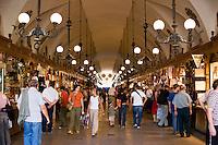 Shoppers in Sukiennice Cloth Hall Kosciol Mariacki in Rynek Glowny Krakow Poland