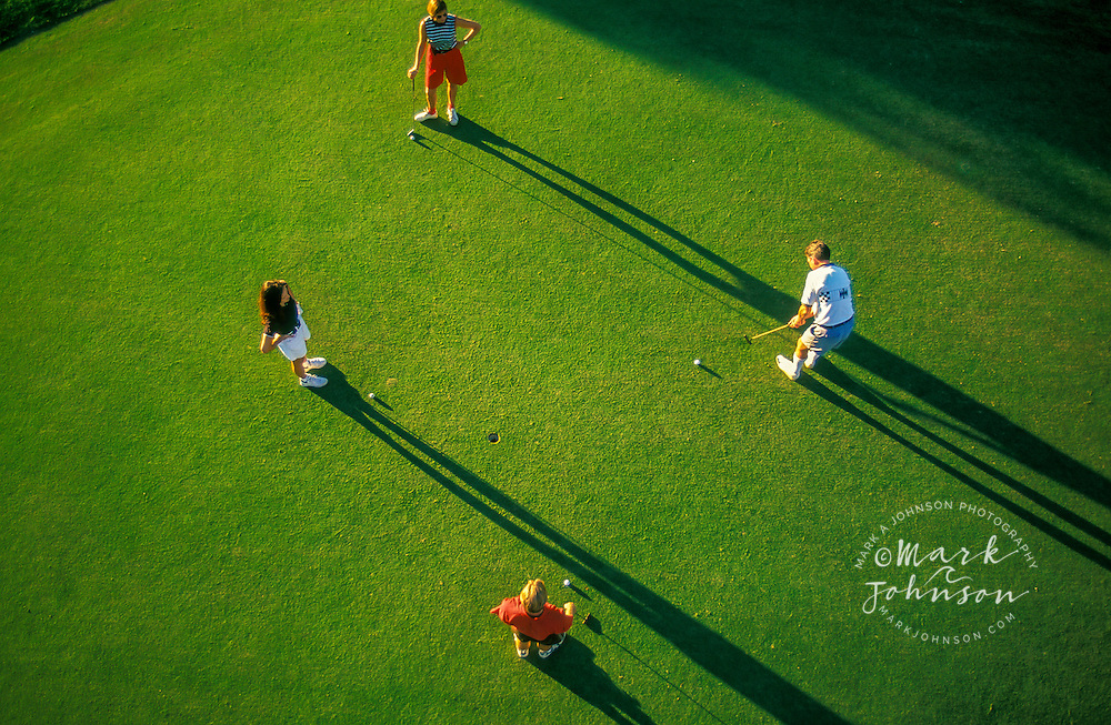 Aerial view of golfers on green, Queensland, Australia ****Model Release available