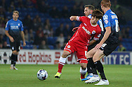 Kim Bo Kyung of Cardiff dribbles through the Bournemouth defence. Capital One Cup, 3rd round match, Cardiff City v AFC Bournemouth at the Cardiff City stadium in Cardiff, South Wales on Tuesday 23rd Sept 2014<br /> pic by Mark Hawkins, Andrew Orchard sports photography.