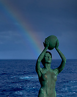 Rainbow ending at the statue on the aft deck of the MV World Odyssey. Image taken with a Leica T camera and 18-56 mm lens (ISO 100, 56 mm, f/7, 1/1250 sec).
