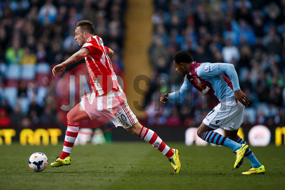 Stoke Forward Marko Arnautovic (AUT) gets away from Aston Villa Forward Leandro Bacuna (NED) - Photo mandatory by-line: Rogan Thomson/JMP - 07966 386802 - 23/03/2014 - SPORT - FOOTBALL - Villa Park, Birmingham - Aston Villa v Stoke City - Barclays Premier League.