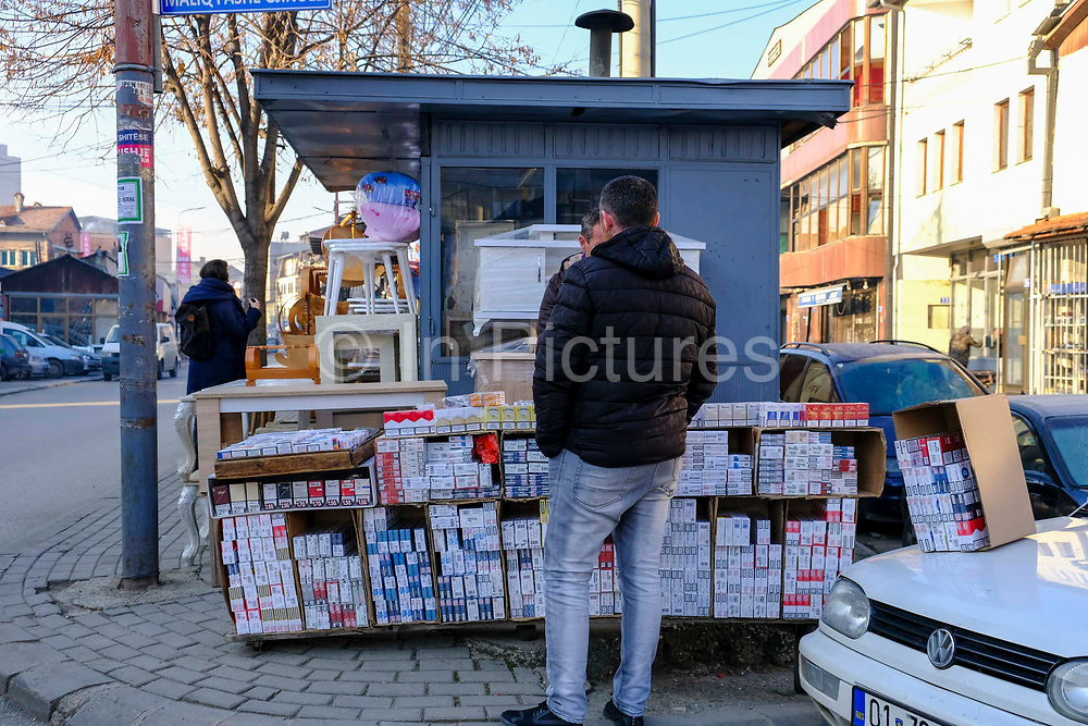 A street stall selling cigarettes to smokers on the 13th of December 2018, in Pristina, the capital and largest city of Kosovo, it has a mainly Albanian population along with other smaller communities.