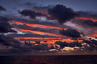 Colorful Dawn clouds over the Pacific Ocean from the deck of the MV World Odyssey. Image 2 of 6 taken with a  Fuji X-T1 camera and 23 mm f/1.4 lens (ISO 200, 23 mm, f/5.6, 1/60 sec). Raw images processed with Capture One Pro.
