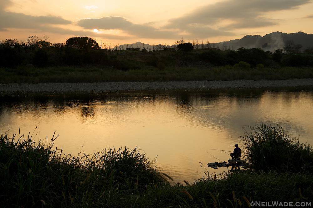 Fishing at sunset in Taipei, Taiwan.