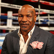 """Boxing promoter Mike Tyson readies himself for a television interview prior to the """"Judgemnt Day"""" boxing event at American Airlines Arena on Thursday, July 10, 2014 in Miami, Florida.  (AP Photo/Alex Menendez)"""