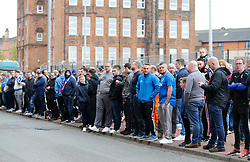 Fans wait outside a press conference at Ibrox where Steven Gerrard will be named the new manager of Rangers, in Glasgow.