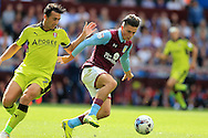 Jack Grealish of Aston Villa  ® goes past Stephen Kelly of Rotherham Utd. EFL Skybet championship match, Aston Villa v Rotherham Utd at Villa Park in Birmingham, The Midlands on Saturday 13th August 2016.<br /> pic by Andrew Orchard, Andrew Orchard sports photography.