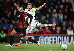 Bournemouth's Charlie Daniels (left) and Norwich City's Dennis Srbeny battle for the ball during the Carabao Cup, Fourth Round match at the Vitality Stadium, Bournemouth.