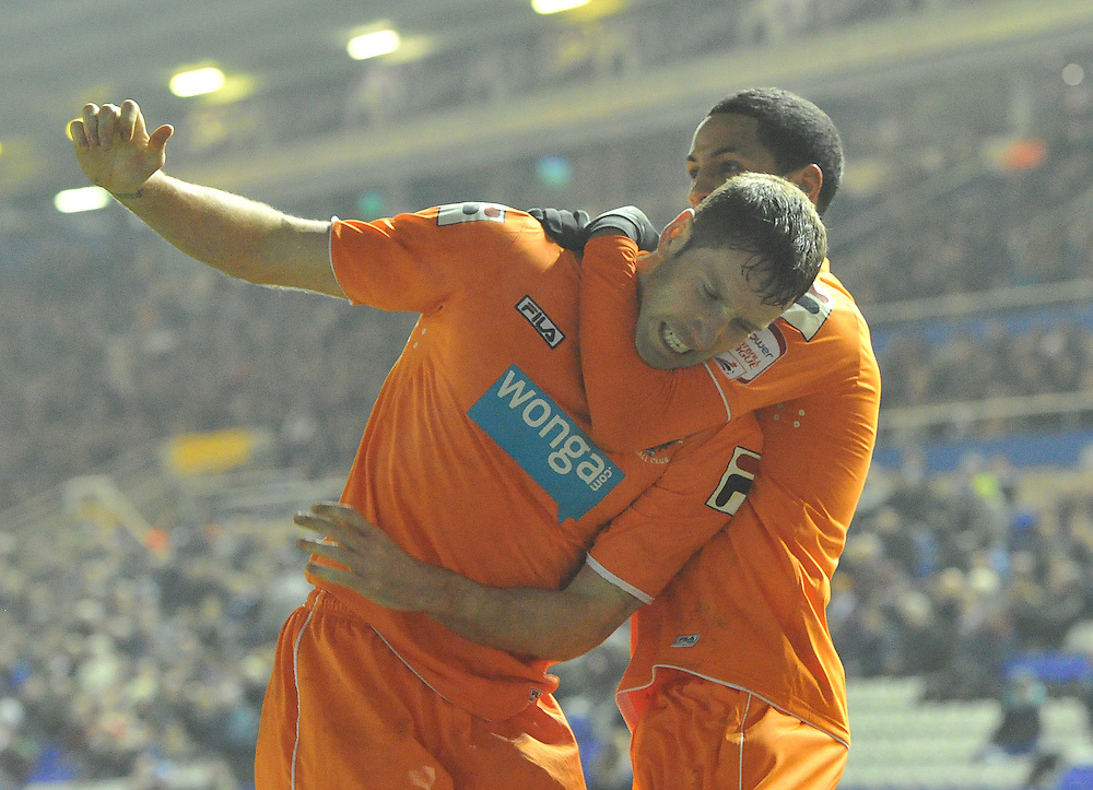 Blackpool's Kirk Broadfoot is almost strangled as he celebrates scoring his sides first goal..Football - npower Football League Championship - Birmingham City v Blackpool - Tuesday 05th March 2013 - St Andrews - Birmingham..© CameraSport - 43 Linden Ave. Countesthorpe. Leicester. England. LE8 5PG - Tel: +44 (0) 116 277 4147 - admin@camerasport.com - www.camerasport.com