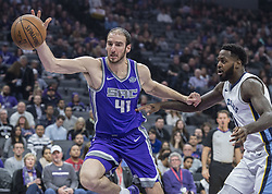 December 31, 2017 - Sacramento, CA, USA - The Sacramento Kings' Kosta Koufos (41) attempts to save the ball as it goes out of bounds against the Memphis Grizzlies' JaMychal Green (0) on Sunday, Dec. 31, 2017, at the Golden 1 Center in Sacramento, Calif. (Credit Image: © Hector Amezcua/TNS via ZUMA Wire)