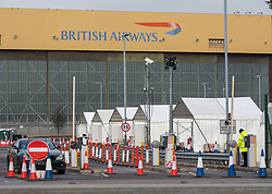 © Licensed to London News Pictures. 28/01/2021. London, UK. A British Airways hanger looms over a Covid Test centre next to London Heathrow as the government prepares to tighten UK boarders with an Australian style quarantine scheme where all UK arrivals will be forced to self-isolate in Covid-19 secure hotels. Today Cabinet Office Minister Michael Gove revealed that there will be no interruption to UK Covid-19 vaccine supplies after the EU urged AstraZeneca to supply it with doses of the Oxford vaccine from UK plants. Photo credit: Alex Lentati/LNP
