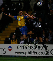 Photo: Steve Bond.<br />Notts County v Hereford United. Coca Cola League 2. 02/10/2007. Clint Easton in an aerial challange