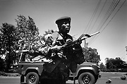 NAIROBI, KENYA - DECEMBER 31, 2007: A soldier of the General Service Unit prepares to enter Kibera slum to quell protests. A surge in violence left scores of people dead in Nairobi as defeated presidential candidate Raila Odinga prepared to declare himself head of state, after rejecting the victory of incumbent president Mwai Kibaki.