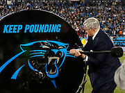 """CHARLOTTE, NC - JAN 24:  Carolina Panthers owner Jerry Richardson hits the""""Keep Pounding"""" drum before the NFC Championship game against the Arizona Cardinals at Bank of America Stadium on January 24, 2016 in Charlotte, North Carolina."""