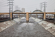 The 6th Street Bridge over the LA River as it rises dramatically when a big rainstorm brings much needed water to the Los Angeles area on December 2, 2014. Downtown Los Angeles, California, USA