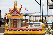 28 JUNE 2006 - CHONG KHNEAS, SIEM REAP, CAMBODIA: A Spirit House (a small Buddhist shrine) on a floating fish farm in the floating village of Chong Khneas, at the northwest end of Tonle Sap Lake, Cambodia's vast inland sea. More than 2,500 people live on the lake in houses that move as the lake expands and contracts with the seasons. During the dry season the lake covers about 2,500 square kilometers. At the peak of the rainy season the Tonle Sap swells to more than 13,000 square kilometers. Photo by Jack Kurtz / ZUMA Press