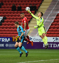 Fleetwood Town goalkeeper Alex Cairns (right) punches clear under pressure from Charlton Athletic's Josh Magennis