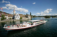 """""""Vom Rheinfall nach Stein am Rhein"""", a river boat tour passing the Burg Hohenklingen Castle and the Rhine promenade. The tour guide describes this stretch as, """"Europe's most beautiful river landscape""""."""