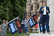 Richard Burgon, Labour MP for Leeds East, addresses NHS workers from the grassroots NHSPay15 campaign outside Parliament before a march to 10 Downing Street to present a petition signed by over 800,000 people calling for a 15% pay rise for NHS workers on 20th July 2021 in London, United Kingdom. At the time of presentation of the petition, the government was believed to be preparing to offer NHS workers a 3% pay rise in recognition of the unique impact of the pandemic on the NHS.