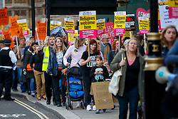 © Licensed to London News Pictures. 15/10/2016. London, UK. Pro-refugee protesters demand the Government to enact Lord Dubs amendment to take more children refugees to Britain at Parliament Square, London on 15 October 2016. Photo credit: Tolga Akmen/LNP