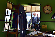 """© Licensed to London News Pictures. 13/03/2013. Duxford, UK Les Millgate, a fighter pilot based at Duxford in the 1950's with No. 64 Squadron, looks through the window of the recreated Watch Office, a forerunner to the control tower. Press preview today 13th March 2013 of """"Historic Duxford"""" designed to explore the RAF's time at the airfield from 1918 to 1961. RAF Duxford is Britain's best preserved Second World War Airfield with a history that dates back to the First World War.  The exhibition opens to the public on the 28th March. Photo credit : Stephen Simpson/LNP"""
