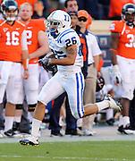 CHARLOTTESVILLE, VA- NOVEMBER 12:  Wide receiver Donovan Varner #26 of the Duke Blue Devils runs for a touchdown during the game on November 12, 2011 at Scott Stadium in Charlottesville, Virginia. Virginia defeated Duke 31-21. (Photo by Andrew Shurtleff/Getty Images) *** Local Caption *** Donovan Varner