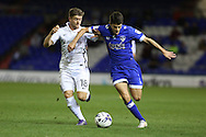 Ryan Flynn of Oldham Athletic runs at Aaron Phillips of Northampton Town during the EFL Sky Bet League 1 match between Oldham Athletic and Northampton Town at Boundary Park, Oldham, England on 16 August 2016. Photo by Simon Brady.