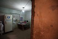 Lima, Peru. Jicamarca. Teresa Sedano Unocc playng with her younger sister in her bedroom