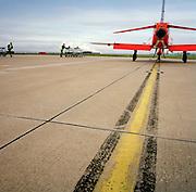Engineering ground staff of the Red Arrows, Britain's RAF aerobatic team during winter training turnaround.