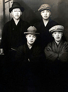 portrait of fashionable dressed young adult boys together Japan ca 1930s