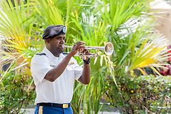 "Sgt. Ovid Williams plays ""TAPS"".  St. Thomas Memorial Day Ceremony and Parade.  Franklin D. Roosevelt Veterans Park.  St. Thomas, USVI.  30 May 2016.  © Aisha-Zakiya Boyd"
