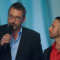 TV hosts Ferenc Rakoczi (L) and Majka or Peter Majoros (R) during The Beauty Queen live TV show hosting the three beauty contests Miss World Hungary, Miss Universe Hungary and Miss Earth Hungary, held in Hungary's tv2 television headquarter in Budapest, Hungary on July 14, 2011. ATTILA VOLGYI