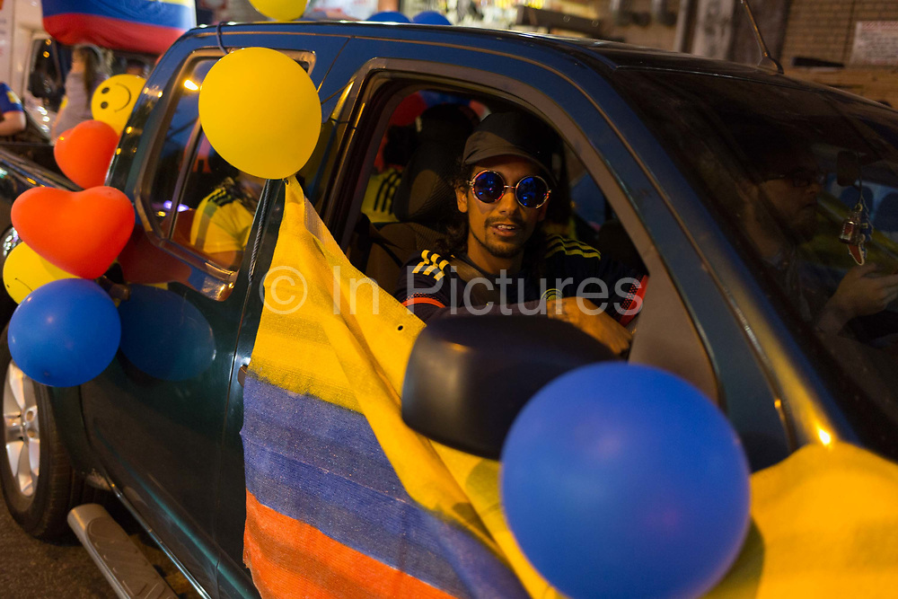 Colombian football fans living in London watch their teams eventual 4-3 loss after penalties with England in the knock-out stage of the World Cup at Elephant and Castle, on 3rd July 2018, in London, England. 15,000 Colombians have established a thriving community in London, many in the south London borough of Southwark, as well as other south American expatriates.