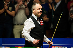 John Higgins walks in for the final session during day seventeen of the Betfred Snooker World Championships at the Crucible Theatre, Sheffield.