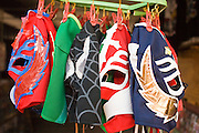 July 13, 2008 -- PHOENIX, AZ: Lucha Libre masks for sale before a Lucha Libre show at El Gran Mercado in Phoenix. Lucha Libre is Mexican style wrestling. There are heros (Tecnicos) and villians (Rudos). The masks are popular as children's gifts and tourist mementos. As the size of the Mexican community in the Phoenix area has grown, attendance at the Lucha Libre shows has increased. Lucha Libre differs from American style entertainment wrestling in several ways, but principally the wrestlers are more acrobatic and rely less on body slams than American wrestling. The shows, which used to be held only periodically, are now held every week at El Gran Mercado, a flea market and swap meet that caters mostly to the Mexican community in Phoenix.   Photo by Jack Kurtz / ZUMA Press