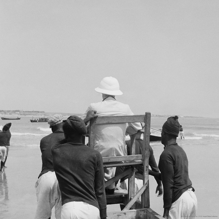 """Passenger Carried in """"Mammy"""" Chair Through Surf,  Accra, Ghana, Africa, 1937"""