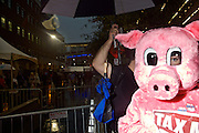 "A woman dressed as a pig holds a sign that says ""Tax Meat"" outside of the gates where delegates enter in to the 2012 Democratic National Convention on Tuesday, September 4, 2012 in Charlotte, NC."