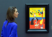 """© Licensed to London News Pictures. 31/01/2013. London, UK A woman looks at Joan Miro's """"Le fernier et son epouse"""" estimated to raise 5.5-7.5million GBP.  Preview of highlights from Sotheby's forthcoming February sales of Impressionist & Modern Art and Contemporary Art in London, including works by Picasso, Bacon, Monet, Richter and Miró. Photo credit : Stephen Simpson/LNP"""