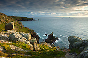 Land's End & Longships Lighthouse from the cliffs of Pedn-men-du. Cornwall, UK.