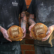Baker Philip Clayton holding a loaf of bread made to mark the occasion of the UK General Election at the Haxby Bakehouse, Yorks artisan bakery in Haxby, North Yorkshire, United Kingdom on 10th December 2019.