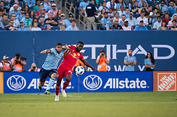 July 8, 2018 - Bronx, New York, United States - New York City midfielder ISMAEL TAJOURI (29) fights for the ball against New York Red Bulls defender KEMAR LAWRENCE (92) during a regular season match at Yankee Stadium in Bronx, NY.  New York City FC defeats the New York Red Bulls 1 to 0 (Credit Image: © Mark Smith via ZUMA Wire)