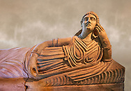 Etruscan Terracotta sarcophagus lid with a female figure reclining, first half of 2nd century BC, inv 15428, The Vatican Museums Rome, Art Background. For use in non editorial advertising apply to the Vatican Museums for a license. .<br /> <br /> If you prefer to buy from our ALAMY PHOTO LIBRARY  Collection visit : https://www.alamy.com/portfolio/paul-williams-funkystock/vatican-museums-etruscan.html<br /> <br /> Visit our ETRUSCAN PHOTO COLLECTIONS for more photos to download or buy as wall art prints https://funkystock.photoshelter.com/gallery-collection/Pictures-Images-of-Etruscan-Historic-Sites-Art-Artefacts-Antiquities/C0000GgxRXWVMLyc