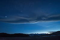 As I headed into the Bighorn Mountains at dusk, this lenticular cloud was hovering over the peaks.