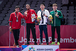 JAKARTA, Aug 24,2018  Hamad Nawad (2nd L) of the UAE,  Khalid ALblooshi (1st L) of the UAE, Nurzhan Seiduali (2nd R) of  Kazakhstan and Kemal Meredov of Turkmenistan pose for photos during the awarding ceremony of Ju-Jitsu Newaza Men's -56 kg competition of the 18th Asian Games in Jakarta, Indonesia, Aug. 24, 2018. Hamad Nawad won the gold medal, Khalid ALblooshi won the silver, Nurzhan Seiduali and Kemal Meredov won the bronze. (Credit Image: © Zhu Wei/Xinhua via ZUMA Wire)