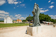 Ivan Mestrovic's sculpture of the medieval Croatian bishop Grgur Ninski (Gregory of Nin) - one of three versions - with the 9th century Church of the Holy Cross in the background, Nin, Croatia