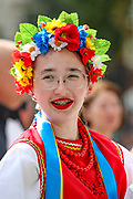 A member of the Ukrainian community in Britain wearing national folk outfit smiles as she poses for a picture outside Downing Street while preparing to celebrate the anniversary of Ukraine's national flag on Westminster Bridge in central London on Sunday, Aug 22, 2021. (VX Photo/ Vudi Xhymshiti)