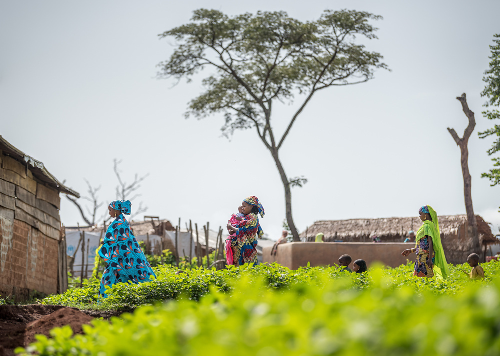 5 June 2019, Gado, Cameroon: A group of women walk with their children through the Gado refugee camp in Cameroon. Supported by the Lutheran World Federation, the Gado refugee camp in he East region of Cameroon hosts more than 25,000 refugees from neighbouring Central African Republic.