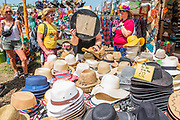 Hats are in high demand due to the sun - a woman checks herself out in a mirror - The 2019 Glastonbury Festival, Worthy Farm. Glastonbury, 27 June 2019